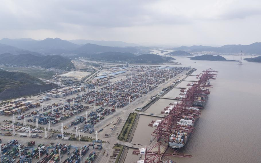 Containers sit stacked next to gantry cranes in this aerial photograph taken above the Port of Ningbo-Zhoushan in Ningbo, China, on Oct. 31, 2018.