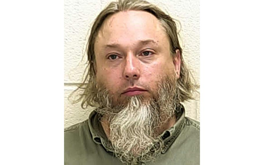 This undated file photo provided by The Ford County Sheriff's Office in Paxton, Ill., shows Michael Hari, a militia leader convicted of masterminding the bombing of a Minnesota mosque. Hari is now known by her transgender identity, Emily Claire Hari.