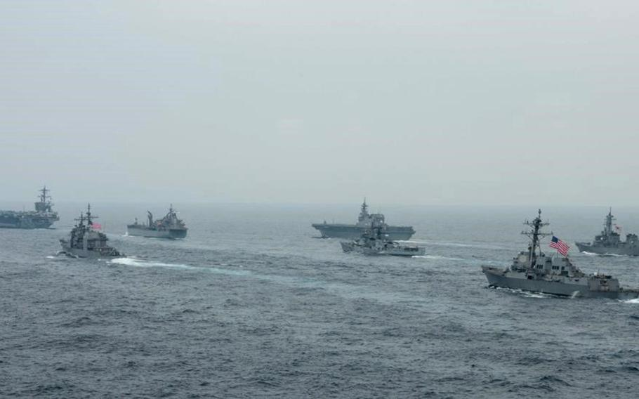 The aircraft carrier USS Carl Vinson and guided-missile cruiser USS Lake Champlain are joined by warships from India, Australia and Japan during the annual Malabar exercise in the Bay of Bengal, Oct. 12, 2021.