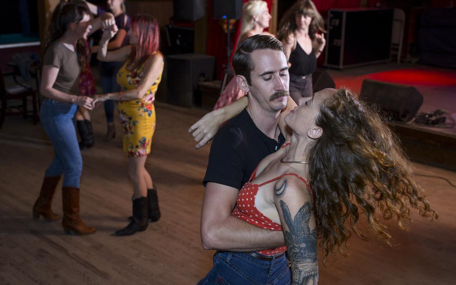 Steven Clarke and Stephanie Gregory, in foreground, two-step during a dance lesson at Sagebrush bar in Austin, Texas, on June 3, 2021.