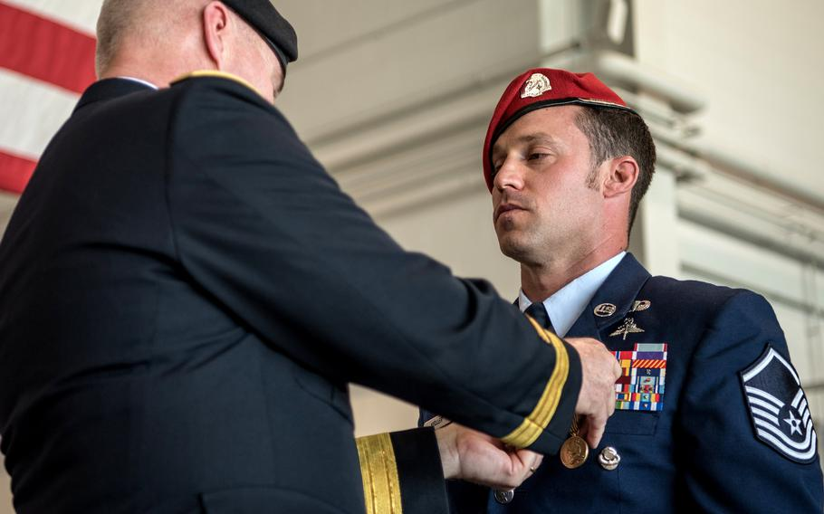 Brig. Gen. Hal Lamberton, left, the adjutant general for the Commonwealth of Kentucky, pins the Airman's Medal to the uniform of Master Sgt. Daniel Keller, a combat controller in the 123rd Special Tactics Squadron, during a ceremony at the Kentucky Air National Guard Base in Louisville, Ky., June 12, 2021.