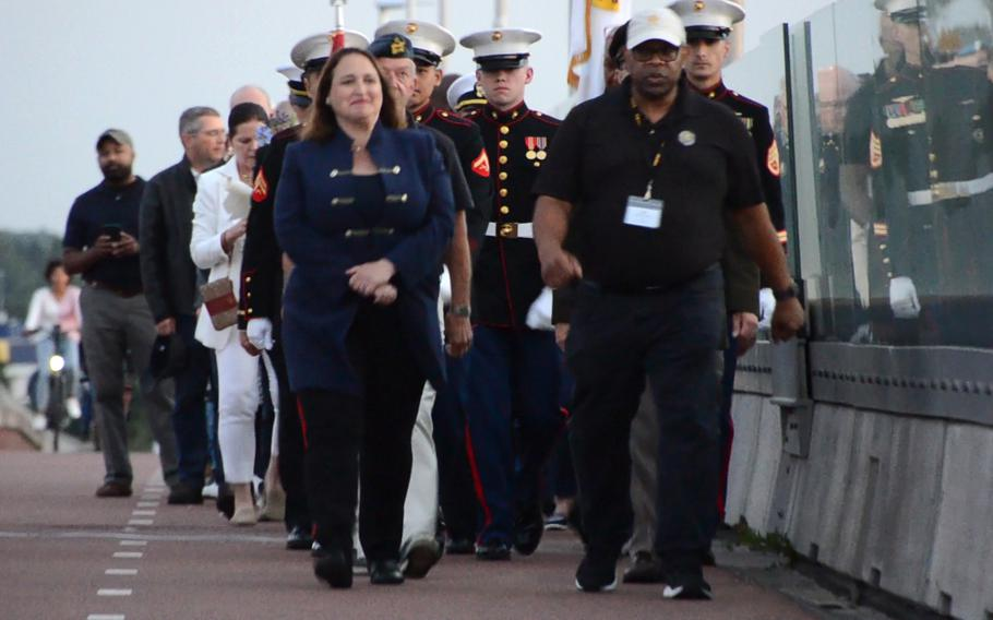 U.S. charge d'affaires to the Netherlands, Marja Verloop, front left, walks alongside Association of the U.S. Army European region president, Tony Williams, on the Oversteek Bridge in Nijmegen, the Netherlands, Aug. 13, 2021, during the Sunset March.