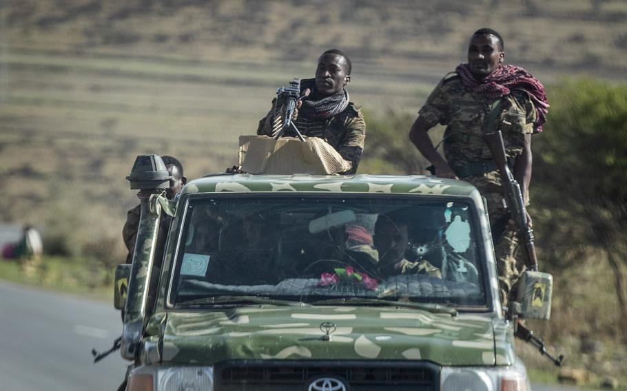 In this Saturday, May 8, 2021 file photo, Ethiopian government soldiers ride in the back of a truck on a road near Agula, north of Mekele, in the Tigray region of northern Ethiopia.