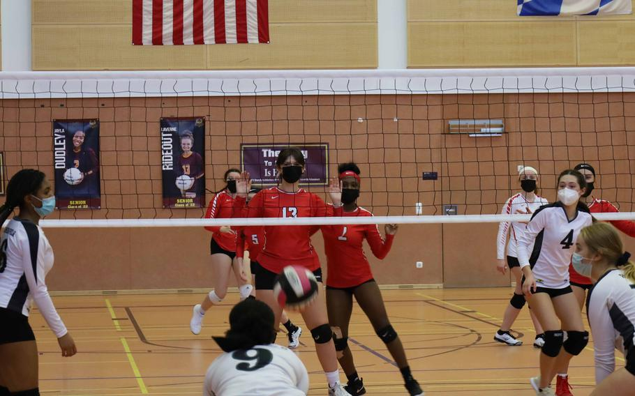 Hohenfels' Kennedy Liverpool, left-center, returns a ball during a volleyball match against Kaiserslautern at Vilseck, Germany, Saturday, Oct. 9, 2021.