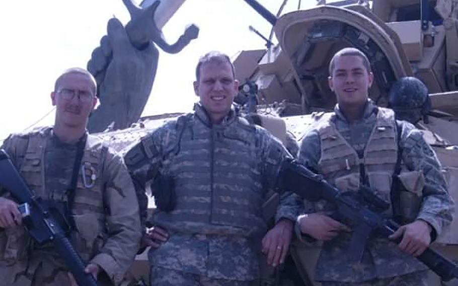 Brandon Harris, left, is pictured in Baghdad, Iraq, during his first combat deployment in 2006. Harris, now a sergeant first class, enlisted right after graduating high school in 2004, inspired largely by the 9/11 terrorist attacks.