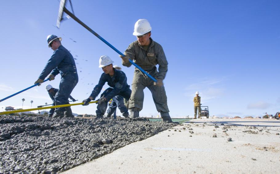 """U.S. Marines prepare and spread concrete during the """"Catalina Island Airport in the Sky"""" project at Catalina Island, California in 2019, the first of two projects on the island so far."""