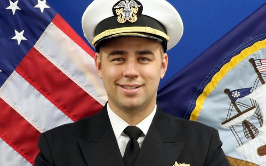 Lt. Ridge Hannemann Alkonis, 33, is a weapons officer aboard the destroyer USS Benfold at Yokosuka Naval Base, Japan, according to his LinkedIn profile.