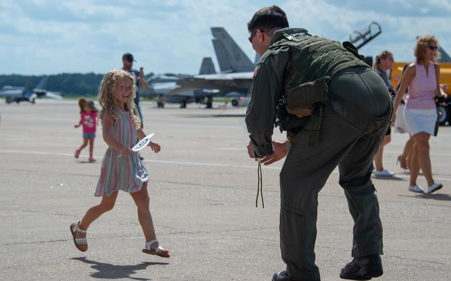 """Families welcome home sailors assigned to the """"Screwtops"""" of Airborne Command and Control Squadron 123 on Naval Air Station Oceana during the squadron's homecoming on July 12, 2021."""