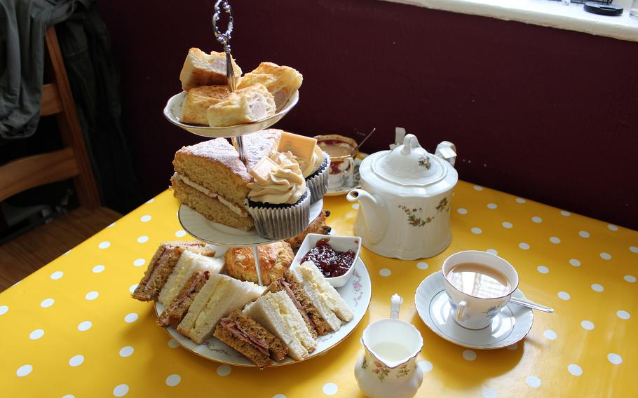 A variety of cakes and sandwiches accompany a traditional afternoon tea service at Barleycorn in Mildenhall, England, on May 24, 2021.