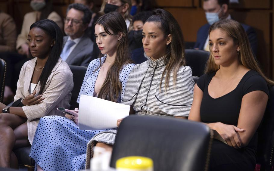 United States gymnasts from left, Simone Biles, McKayla Maroney, Aly Raisman and Maggie Nichols, arrive to testify on Capitol Hill in Washington on Wednesday, Sept. 15, 2021, during a hearing about the FBI's handling of the Larry Nassar investigation. Nassar is now serving decades in prison after hundreds of girls and women said he sexually abused them under the guise of medical treatment when he worked for Michigan State and Indiana-based USA Gymnastics, which trains Olympians.