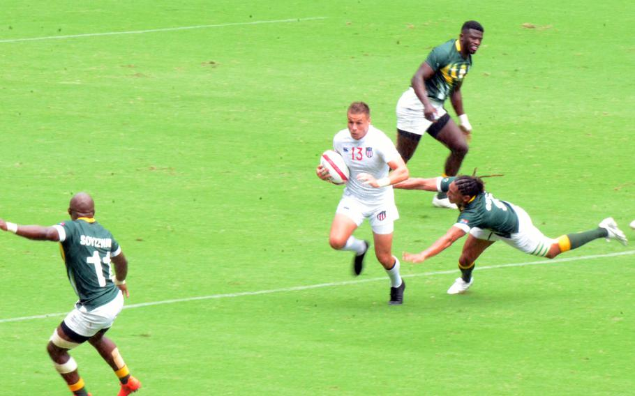 Former Army specialist Cody Melphy advances the ball during the U.S. Eagles' Olympic rugby sevens game against South Africa, Tuesday, July 27, 2021.