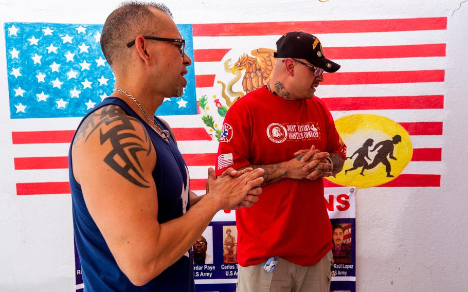 """From left, Michael Evans and fellow deported veteran Ivan Ocon talk about life in Mexico at the """"Juarez Bunker,"""" a support shelter for deported veterans in Cuidad Juarez."""