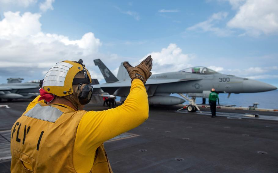 An F/A-18E Super Hornet prepares to take off from the aircraft carrier USS Carl Vinson in the South China Sea, Monday, Sept. 6, 2021.
