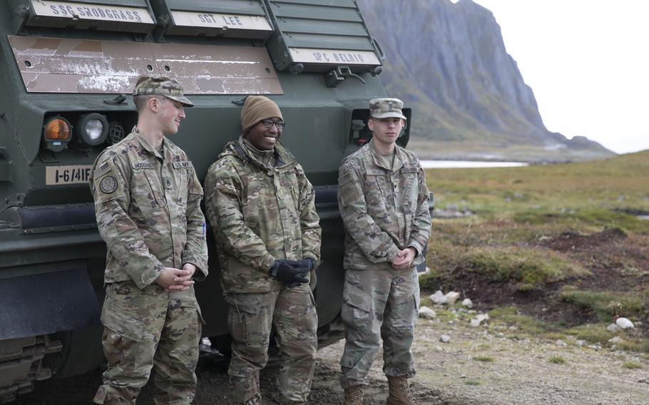 A section of Multiple Launch Rocket System crewmen, assigned to 1st Battalion, 6th Field Artillery Regiment, 41st Field Artillery Brigade, relax before firing their artillery during the Thunder Cloud live-fire exercise in Andoya, Norway, on Sept. 15, 2021.