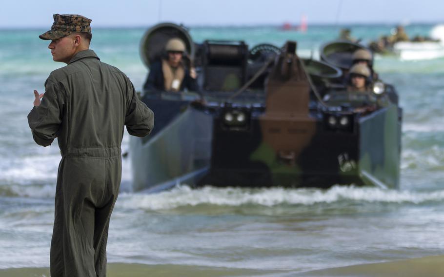 Marines from Company B, 3rd Assault Amphibian Battalion train in assault amphibious vehicles at Camp Schwab, Okinawa, June 2, 2021.