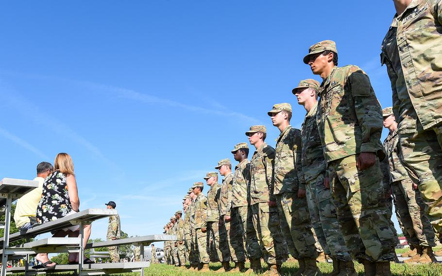 Family members watch their soldiers graduate from the Army's Basic Airborne Course at Fort Benning, Ga., on Friday, May 21, 2021. It marked the first airborne school graduation open to family and loved ones since the beginning of the coronavirus pandemic.