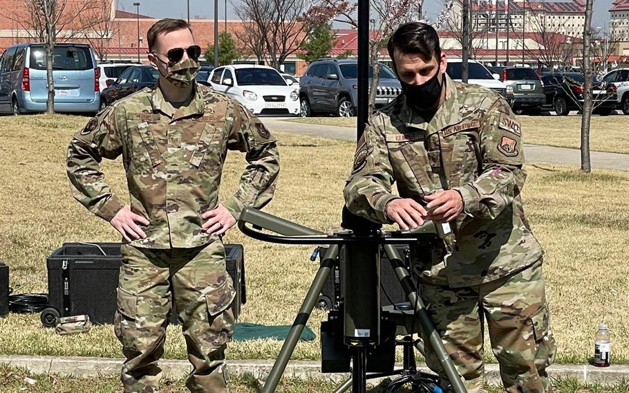 Airmen with the 607th Combat Weather Squadron show off their TMQ-53, a portable weather station, recently at Camp Humphreys, South Korea.