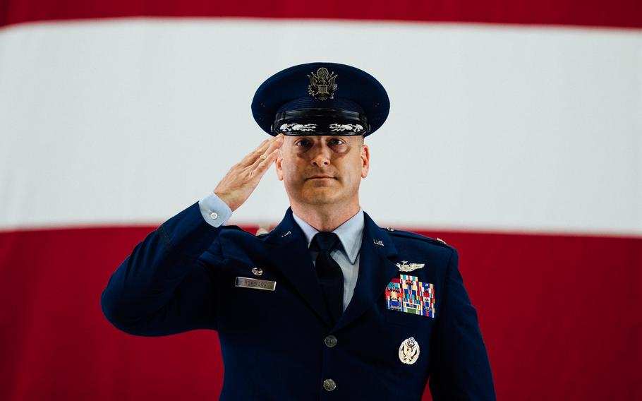 Col. Chris Robinson, 375th Air Mobility Wing commander, renders his first salute to members of Team Scott and the Showcase Wing after assuming command of the 375th AMW on Scott Air Force Base, Ill., July 1, 2021.