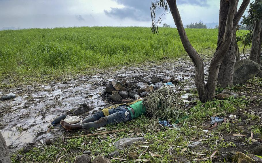 The dead body of an unidentified man lies on the ground near the village of Chenna Teklehaymanot, in the Amhara region of northern Ethiopia Thursday, Sept. 9, 2021.