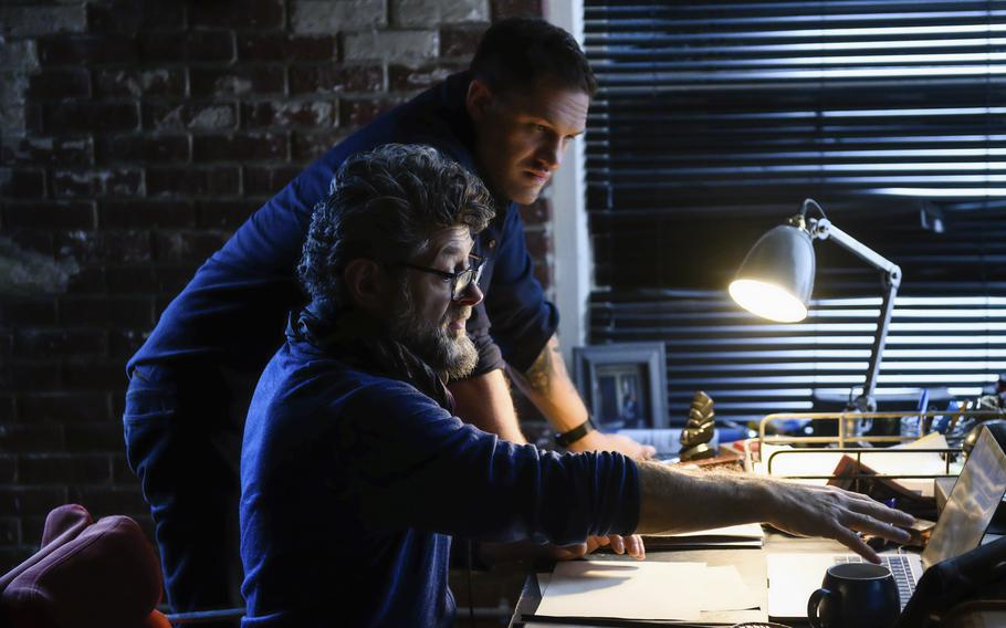 """This image released by Sony Pictures shows Tom Hardy, background, and director Andy Serkis on the set of """"Venom: Let There Be Carnage."""""""