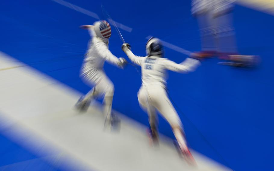 A U.S. women's Olympic fencing team cadet athlete, Amanda Pirkowski, left, spars with Olympian Kelley Hurley inside Lotus Culture Center Arena at the Atago Sports Complex in Iwakuni, Japan, July 16, 2021.