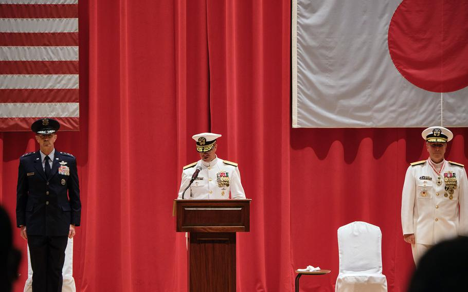 Rear Adm. Carl Lahti speaks after taking the helm of U.S. Naval Forces Japan and Navy Region Japan at Yokosuka Naval Base, Japan, Wednesday, July 14, 2021. He is flanked by the outgoing commander, Rear Adm. Brian Fort, and Air Force Lt. Gen. Kevin Schneider, commander of U.S. Forces Japan.