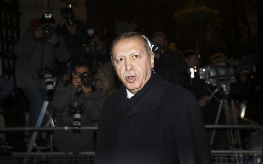Recep Tayyip Erdogan, Turkey's president, departs following a multilateral meeting on the sidelines of the North Atlantic Treaty Organisation summit in London on Dec. 3, 2019.