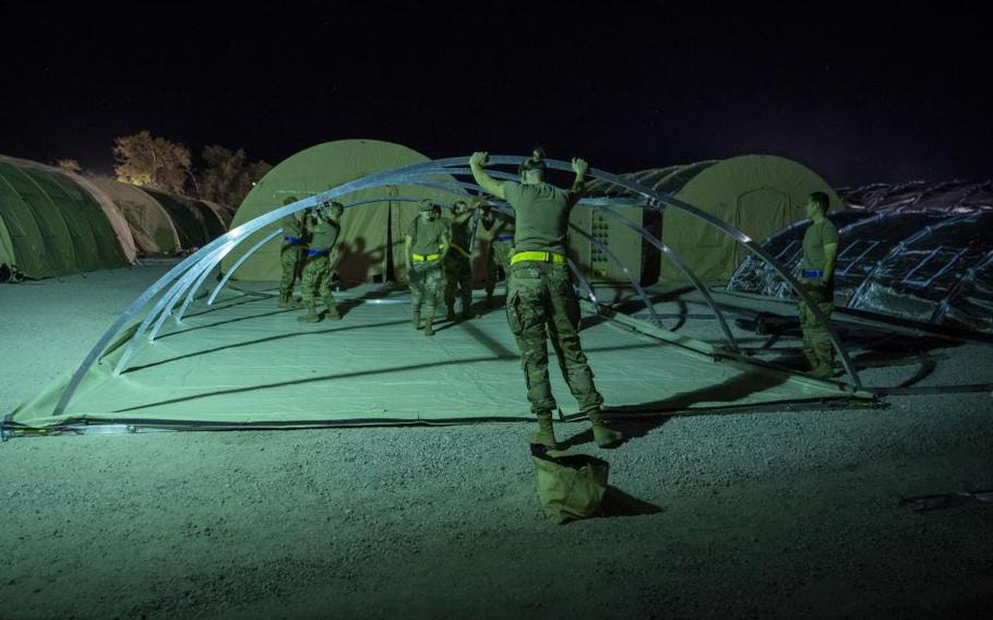 Airmen with the 635th Material Maintenance Squadron, 49th Civil Engineer Squadron, and the 49th Wing set up the foundation of a housing tent as part of Task Force-Holloman, Aug. 27, 2021, on Holloman Air Force Base, N.M.