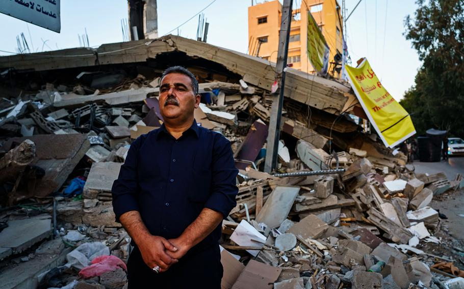 Samir Mansour stands before the remains of his bookstore in Gaza City on Wednesday, May 26, 2021. The bookstore, a Gaza cultural lodestar, was destroyed in an Israeli bombardment during the last escalation, which lasted 11 days between Israel and Gaza military factions.