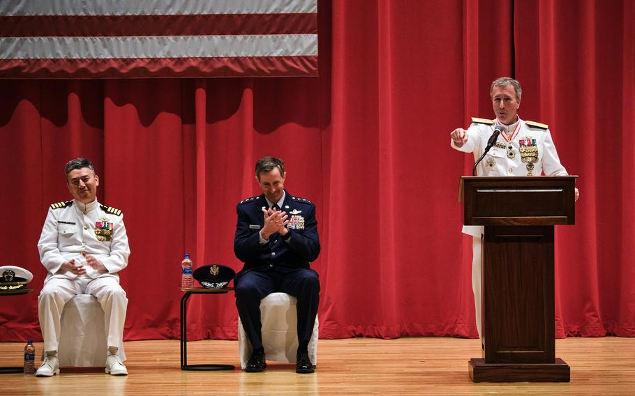 Rear Adm. Brian Fort speaks after handing command of U.S. Naval Forces Japan and Navy Region Japan to Rear Adm. Carl Lahti, far left, at Yokosuka Naval Base, Japan, Wednesday, July 14, 2021.