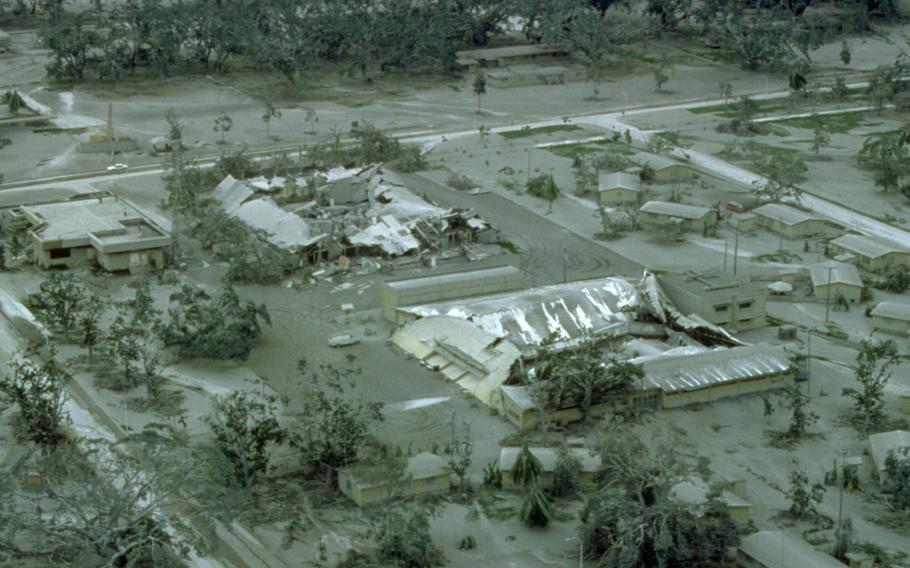 The roofs of hangars at Clark Air Base, Philippines, are collapsed under the weight of rain-saturated ash nine days after Mount Pinatubo's eruption on June 15, 1991.