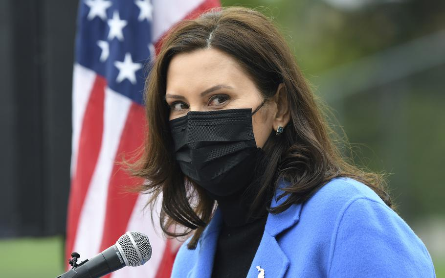 Michigan Gov. Gretchen Whitmer attends an event in Ypsilanti, Mich., on April 12, 2021. Whitmer signed legislation on Wednesday that makes it easier for veterans and their families who are licensed professionals to continue their careers when they move to the state.