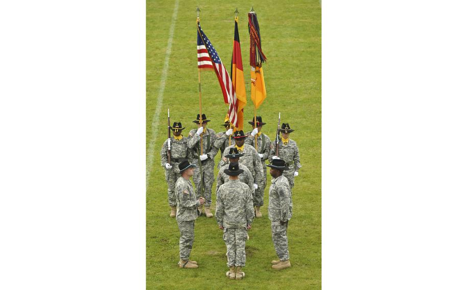 The 2nd Cavalry Regiment displays national flags and the regimental guidon during a change of responsibility ceremony in 2014 at Rose Barracks in Vilseck, Germany. The U.S. and German flags were stolen from the regiment's headquarters overnight between Oct. 3 and Oct. 4, 2021, Army officials said. A Confederate battle flag was found on a flagpole outside and removed upon discovery, officials said.