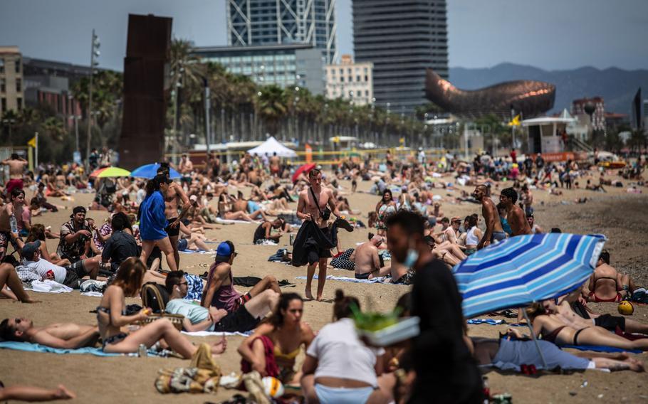 Visitors sunbathe on Barceloneta beach in Barcelona, Spain, on June 5, 2021.
