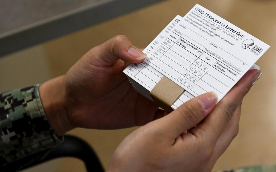 COVID-19 immunization cards are distributed to vaccine recipients following their vaccination. Italy has recognized the cards for Americans living in the country, but it's unclear whether they'll be recognized when new rules take effect requiring a so-called green pass for people to eat inside restaurants or go to movie theaters, gyms and other venues.