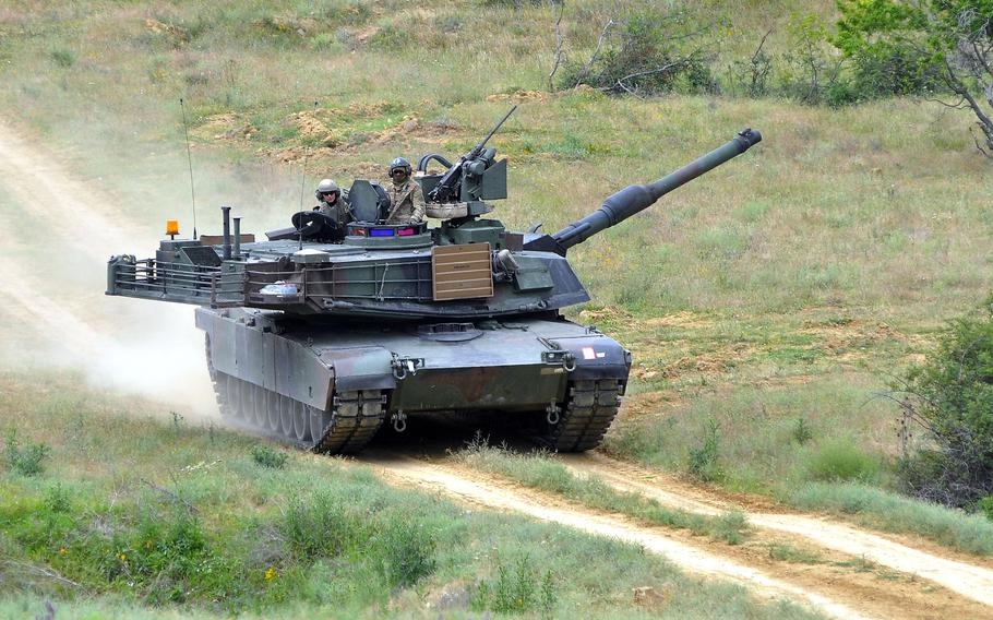 A U.S. Army M1A2 Abrams tank rumbles across Novo Selo Training Area, Bulgaria, in 2015. Poland announced July 14, 2021, that it will purchase 250 of the tanks from the U.S., at a cost of $6 billion.