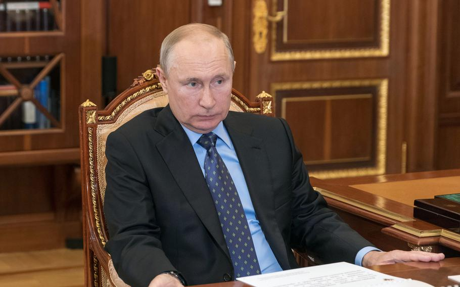 Russia's President Vladimir Putin attends a meeting at the Kremlin in Moscow on June 7, 2021.