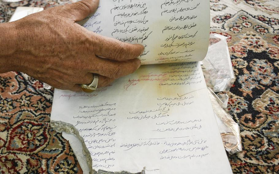 A notebook belonging to Shukria Ahmadi, who is missing following a deadly bomb blast, contains her notes and homework, said her father Abdullah Ahmadi, at his house in western Kabul, Afghanistan on May 31, 2021.