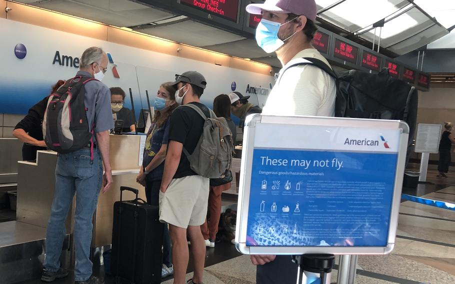 Passengers check in for flights at Denver International Airport on June 5, 2021. Germany tightened coronavirus restrictions in mid-August for travelers from the United States, where the delta variant has pushed new infections back up to nearly 129,000 a day.