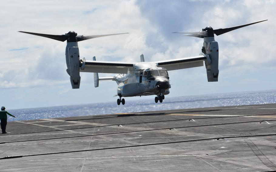 A tiltrotor CMV-22B Osprey lands on the flight deck of the USS Carl Vinson Aug. 14, 2021, as the carrier steamed north of Hawaii during Large-Scale Exercise 2021.