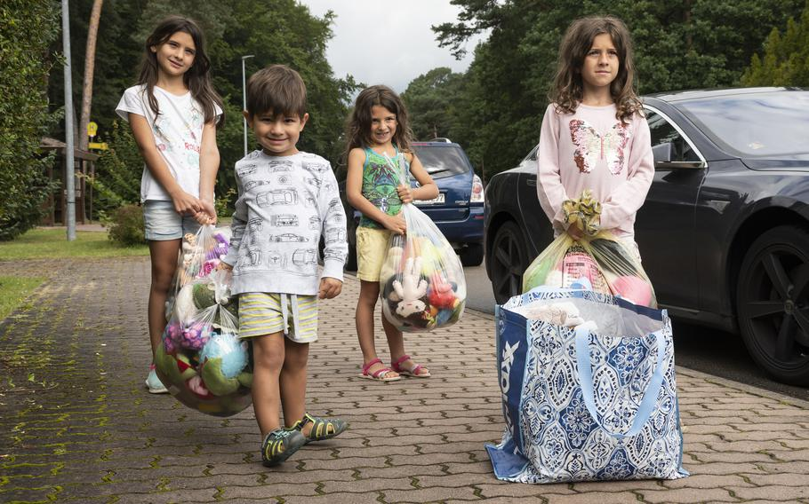Nadia Perez, left, and her siblings Rodrigo, Yvette and Astrid bring donations to a drive for Afghan refugees at Ramstein Air Base on Aug. 26, 2021.