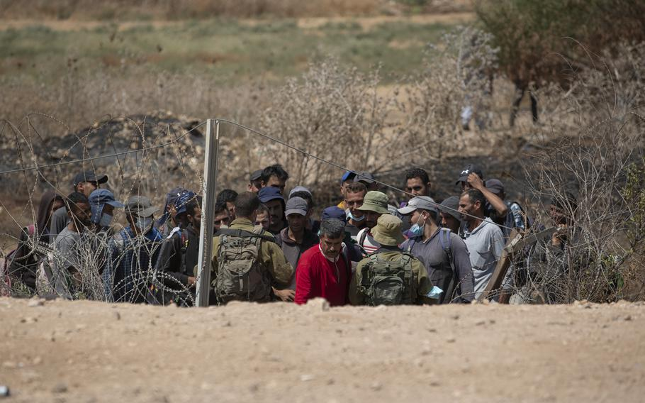 Israeli troops carry out security checks on Palestinian laborers in the West Bank village of Jalameh, on Monday, Sept. 6, 2021. Israel on Tuesday launched airstrikes on Gaza sites after incendiary balloons were sent into Israel.