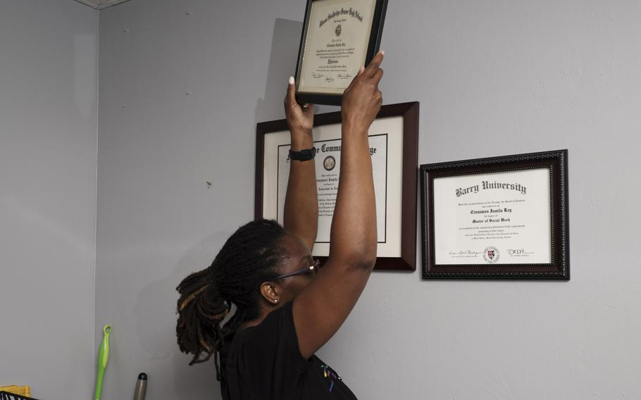 Natalie Rowe packs up Cinnamon Key's diplomas from her office in Miami on May 28, 2021.