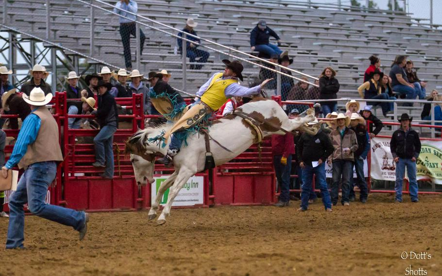 Jaden Clark competes for the University of Wyoming at the 2014 Sheridan College Rodeo in Sheridan, Wyo. Clark, a specialist with the Nebraska Army National Guards 1-134th Cavalry Squadron, is looking to earn his spurs, a rite of passage for cavalry scouts.