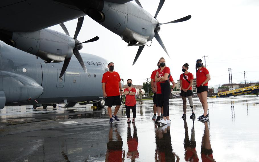 Members of the U.S. Paralympic team, photographed on Aug. 18, 2021, next to a C-130J Super Hercules, arrived at Yokota Air Base in western Tokyo, Japan. They will train there until the games begin Aug. 24, 2021.