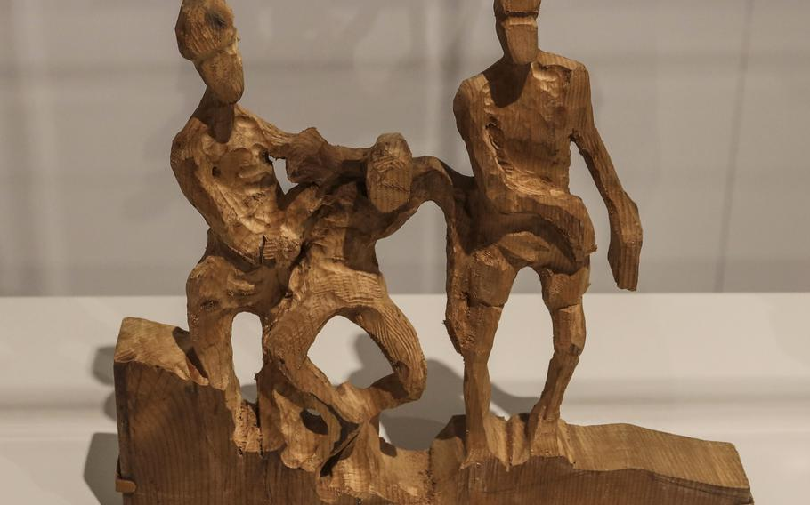 A carving by Bataan Death March survivor Pfc. Clayton Rollins in the Art of Soldiering Gallery at the National Museum of the United States Army.
