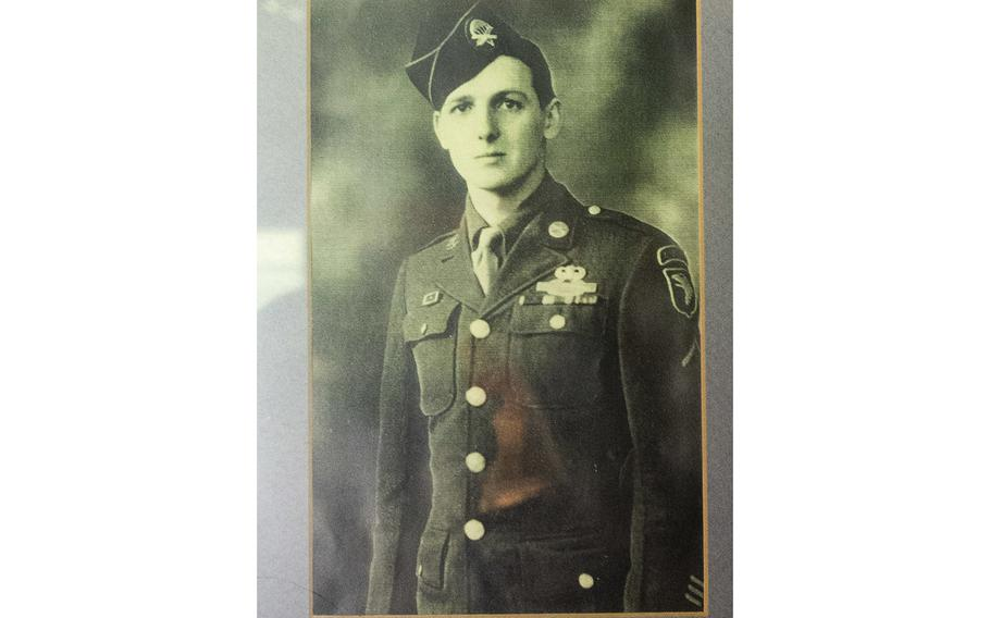 """A photo of then Pvt. Jim """"Pee Wee"""" Martin, hangs on the wall inside his Xenia, Ohio, home, on April 15, 2021. Martin served as a paratrooper assigned to 101st Airborne Division, 506th Infantry Regiment, G Company, out of Fort Campbell, Kentucky."""