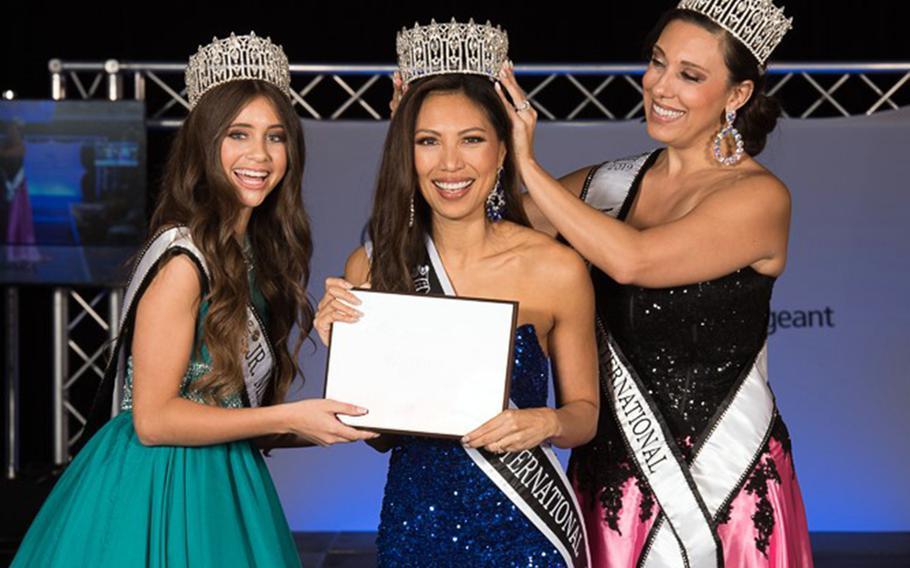 Air Force Maj. Raliene Banks, center, won her third title, Mrs. Regency International, in Las Vegas on July 31, 2021.