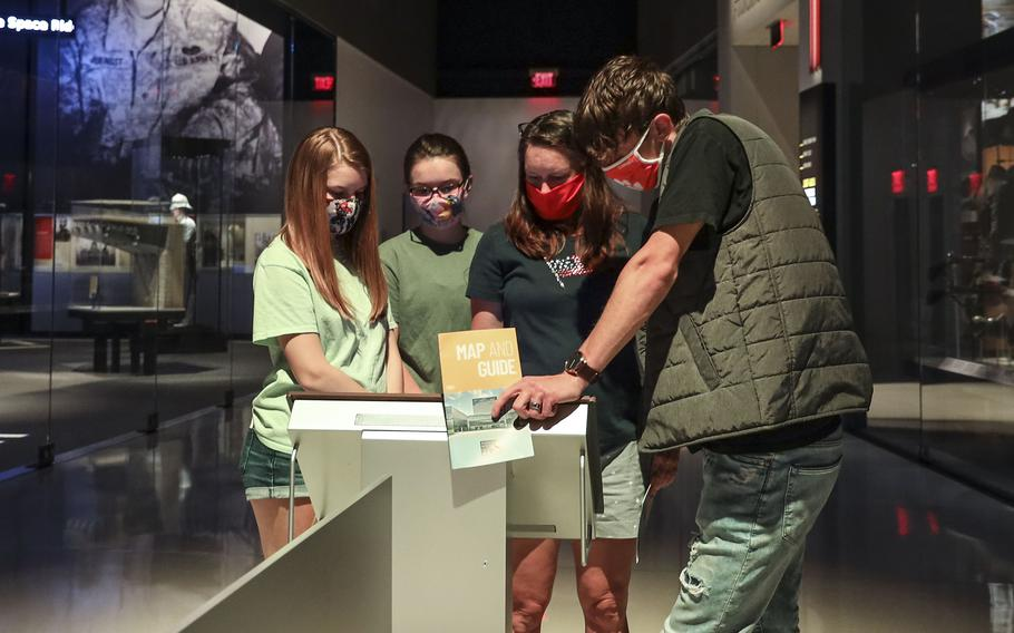 Visitors to the National Museum of the United States Army look at an interactive exhibit on the museum's reopening day, June 14, 2021.