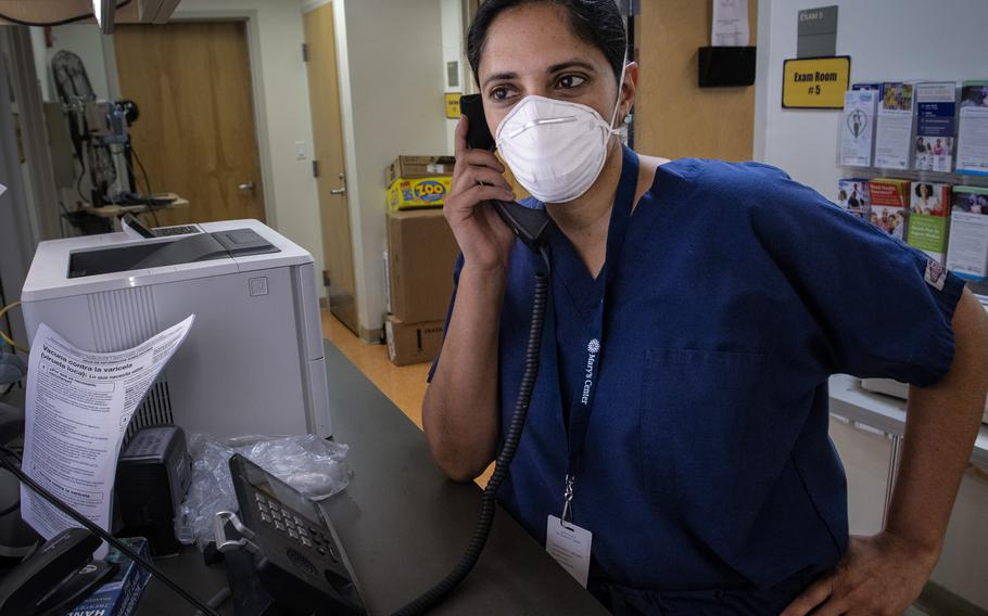 Kavita Patel — a primary care physician shown here at the Adelphi, Md., location of Mary's Center — plans to get a booster shot.